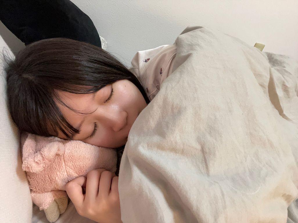 眠りにつく飯田さん
