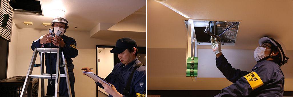 天井裏を確認するKDDIのスタッフ