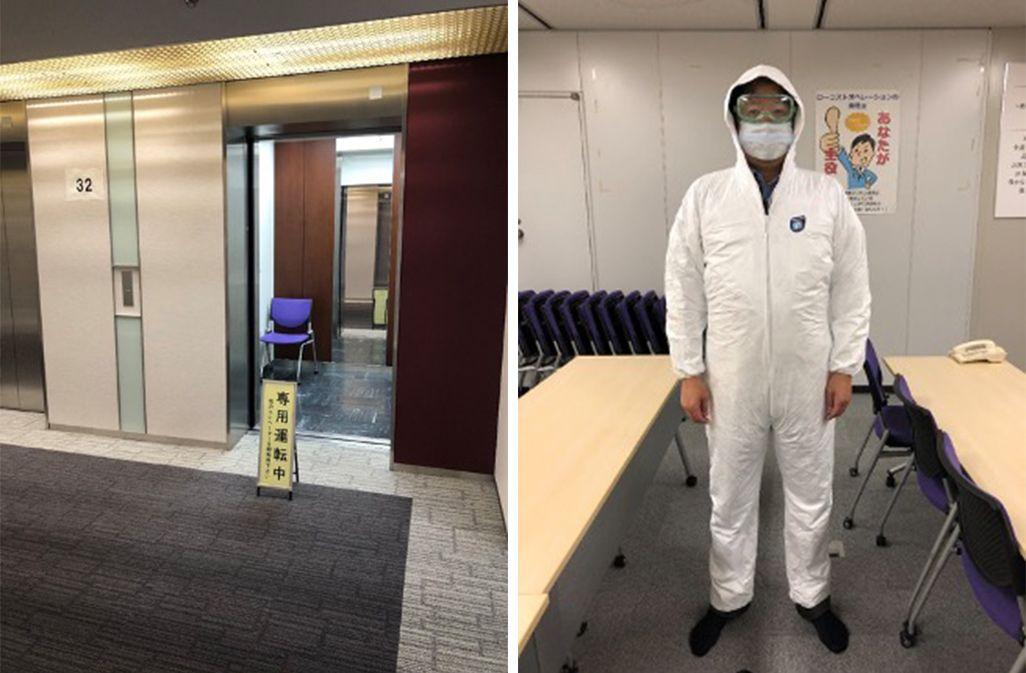 KDDI運用本部のエレベーター、防護服を着用した男性