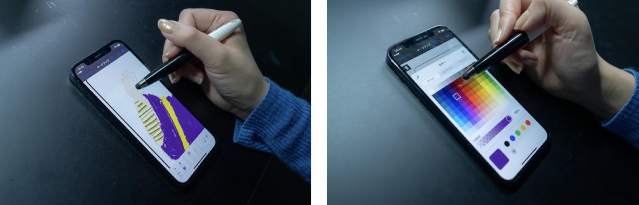 KDDIのコンセプトショップ GINZA 456 とチームラボとのコラボによる体験型イベント Walk, Walk, Walk Home においてスマホの専用アプリでぬり絵する女性