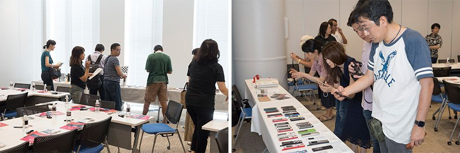 INFOBARファンミーティング新宿での展示物を撮影する参加者たち
